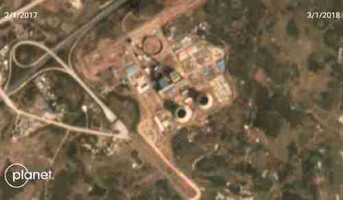 Satellite image of coal-fired power plant in Guangdong province, China. The two cooling towers are clearly visible. (Planet Labs)