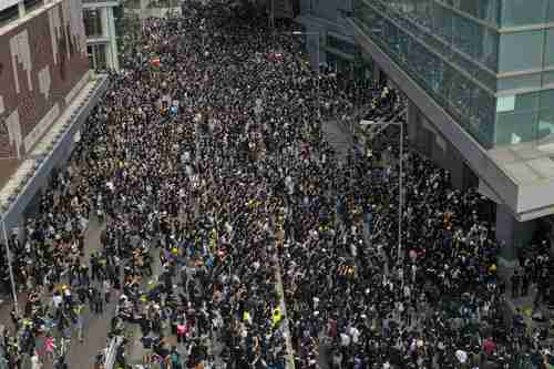 Protesters outside police headquarters in Hong Kong on Friday (SCMP)